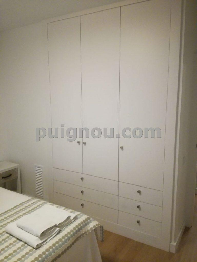 Fusteria Puignou-armari lacat blanc habitació de matrimoni